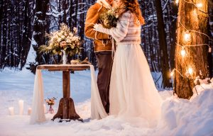 Woman and man getting married in the snow
