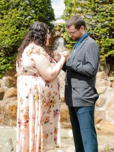 couple getting married by a waterfall